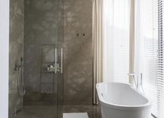 Grey Marble Bathroom with Venetian Blinds and Walk-in Shower