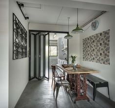 Characterized by white walls and minimal ornamentation the space is kept simple and clean to bring out the charm of the industrial Scandinavian interior.          4-room HDB flat