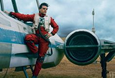 Dashing Resistance pilot Poe Dameron (Oscar Isaac) stands alongside his trusty X-wing fighter. Photograph by Annie Leibovitz.