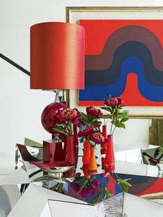 Artful opulence: the home of Perth designer Christian Lyon: A vintage Maison Jensen enamelled lamp and Victorian coloured glass vases sit atop Mattia Bonetti's Polyhedral (2004) cabinet in the foyer, with a John Coburn abstract work in the background.