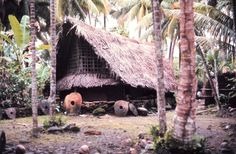 Traditional style structure with stone money indicating great wealth. Most stones were mined on Palau and carried by outrigger canoe some 450 kilometers mi). South Pacific, Pacific Ocean, Canoe House, Federated States Of Micronesia, Outrigger Canoe, Legal Tender, Small Island, Australia Travel, Underwater