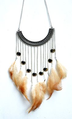 A personal favorite from my Etsy shop https://www.etsy.com/listing/578140601/tribal-boho-feather-necklace-chain