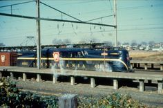 Pennsylvania Railroad GG-1 # 4861 at the platform of the Lancaster station in 1960.