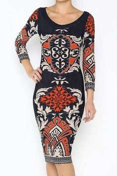 This printed scoop neck dress has a great length for all occasions, go from work to play with ease. The navy and orange make a beautiful contrast that looks great on everyone! Would pair great with black or nude pumps.