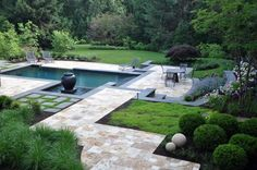 Photo of a transitional landscape with a water feature. #travertinepavers