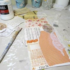 Pasting down the first layers of old vintage and patterned papers.  A new mixed media work in progress.  Mixed media art.