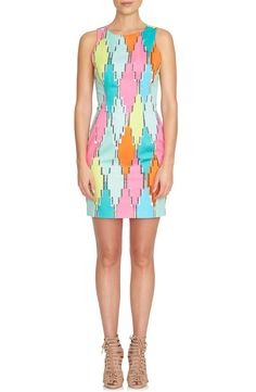 Loving this eye-catching sheath dress! It also features a cutout back for a flirty touch.