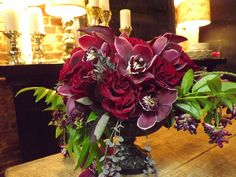 Fall is in the air.  A design for an upcoming fall wedding featuring garden roses, cymbidium orchids, Japanese wisteria.