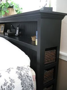 love the storage in this headboard...just think of all the junk I could fit in there!