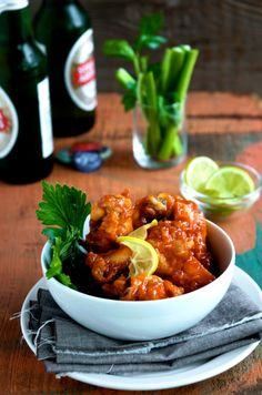 Sriracha Chicken Wings Recipe - So easy, addicting and perfect for parties. From @whiteonrice