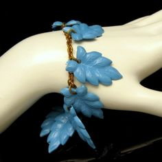 LOVELY VINTAGE CELLULOID LEAVES! What a great version of the charm bracelet. The pale blue carved celluloid dangles make beautiful charms. $75. See More Beautiful Vintage Bracelets in My Shop: https://www.etsy.com/shop/MyClassicJewelry?section_id=13113944