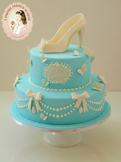 Blue & white shoe cake with butterfly and pearl detail