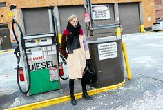 Lina Berg in a 3.1 Phillip Lim coat, Balenciaga bag, and Dr. Martens boots