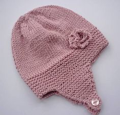 Charlotte - Earflap Hat with Rose Flower : Charlotte – Baby Earflap Hat with Rose Flower Knitting pattern by Julie Taylor Baby Hat Knitting Pattern, Baby Hat Patterns, Baby Hats Knitting, Knit Patterns, Knitted Hats, Knitting Toys, Charlotte Baby, Crochet Baby, Crochet Beanie