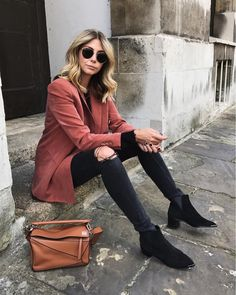 Emma Hill style; Terracotta blazer, round ray ban sunglasses, ripped knee black wash skinny jeans, tan leather Loewe puzzle bag, black suede Acne Jensen boots