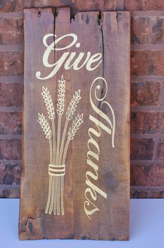 Give thanks rustic wall hanging. Made of reclaimed pallet wood measures approx. 22 inches long and 10 inches in width. Gold paint with stained background. Saw tooth hanger on back for easy and quick d