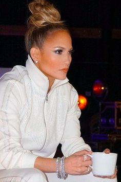 """Let's get loud, because none other than the OG fly girl, """"Jenny from the block"""" (that's right — Jennifer Lopez), is launching her own makeup Jlo Makeup, Hair Makeup, J Lo Fashion, Celebrity Makeup, Mode Outfits, Ponytail Hairstyles, Top Knot, Mode Inspiration, Hair Dos"""