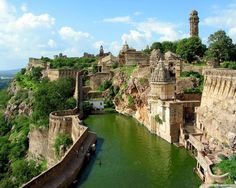 Chittorgath (Chittaurgarh) Fort, India.   This is Indias largest fort, a water fort consisting of 84 water bodies. To arrive at the fort you must scale a one mile lone serpentine road through seven huge gateways which are guarded by several watch towers and massive iron spiked doors.