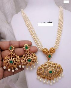 Gorgeous and traditional temple jewelry necklace set from our indian bridal collection! Agold and pearl set with cz stone embellishments Pearl Necklace Designs, Gold Earrings Designs, Necklace Set, Real Gold Jewelry, Gold Jewelry Simple, Jewlery, Gold Bangles Design, Gold Jewellery Design, Bridal Jewellery Inspiration