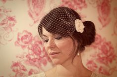 Hey, I found this really awesome Etsy listing at http://www.etsy.com/listing/128867484/birdcage-veil-with-detachable-flower