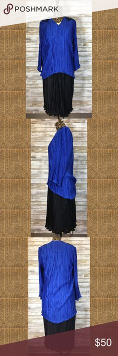 """Vintage Karen Lawrence Blue/Black Sequin Dress 16 Vintage Karen Lawrence blue and black crinkle dress with sequined shoulders. This dress has the appearance of a two piece. Perfect dress for Mother of the Bride or Groom - or even Grandmother. Classic design.  Size 16.  Condition: pre-owned in good condition- some wear to a couple of the rhinestones.  Made in the USA.  Material: 100% polyester.  Measurements (flat): armpit to armpit: 20.5""""; waist: 12.5 - 19.5""""; bottom hem: 28""""; length: 42""""…"""
