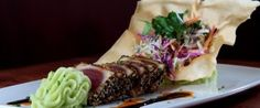 Sesame Seared Sashimi Grade Ahi Tuna epitomizes the focus we have on procuring the highest quality fresh products. This melt in your mouth tuna is served with Asian slaw and wasabi mashed potatoes