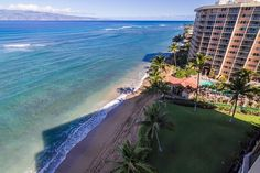 A bird's eye view of the beach and the ocean from the lanai of Valley Isle Resort 1110.