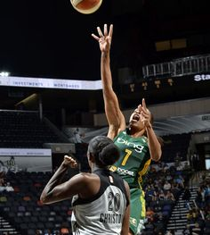 Tina Thompson of the Storm rises above Shameka Christon of the Silver Stars on her way to 21 points Friday night.