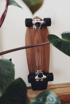 """Made from a real walnut veneer (top and bottom) sandwiching layers of maple in between. Each board features a slight kick in the tail for added control with turns. Top deck has spray-on clear grip tape (allowing the wood to be seen through). 22"""" in length. Comes as a complete skateboard (ready to be ridden). Made in California."""