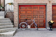 Today's #TuesdayTip is all about securing your #garage - Your garage door should be as secure as the rest of the external doors surrounding your home in order to prevent break-ins. Be sure to check that your garage door securely locks. Some options include having a deadbolt, multiple locks, or a padlock along with a digital pass code. Garage doors should also always be made of a solid material. Fiberglass, solid wood, solid wood core, and metal doors are best.