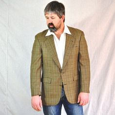 I love this gorgeous designer sport coat for men.  Not your average color or style but not over the top either.  Beautiful.