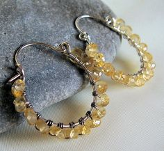 Citrine and sterling silver wire wrapped hoop earrings.