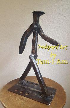 Junkyard Art by Tam-I-Am. Railroad spikes repurposed.