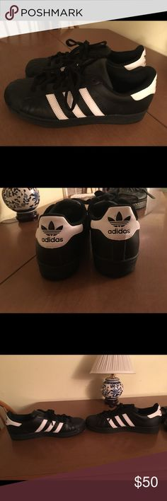 Adidas black Superstars Men's 8/women's 10 black and white leather original superstars. Worn only a handful of times, I. Great condition. Love them a lot, but a tad too big for me! adidas Shoes Sneakers
