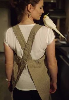 Cissy models the Orkney natural linen pinafore. No ties, just a simple cross over.
