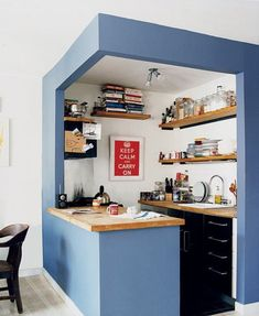 particularly like how the work space is carved out of the wall and both opens and closes the kitchen off from its surroundings