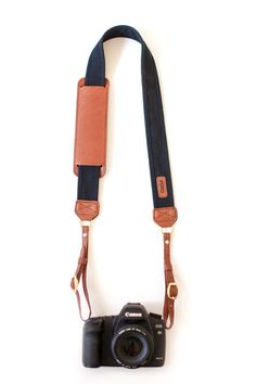 The Black Fotostrap - a black canvas and leather camera strap!  All Fotostraps are made in the USA, 10% of proceeds are donated to Fotolanthropy, and offer custom monogramming to the leather shoulder pad.  Add your name, initials, monogram, or even a business logo!  Shop at www.fotostrap.com.
