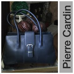 Pierre Cardin Black Leather Handbag Pierre Cardin Black Leather Handbag. Does have a small leather coin purse and buttercream satin lining. Lots of pockets and very beautiful. Pierre Cardin Bags