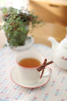 I've never had a cup of tea with a hand-tied bow on it! It's like giving a gift to myself ~ indeed, something we all need!