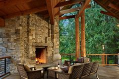 Gorgeous stone outdoor fireplace. Discovered on www.Porch.com