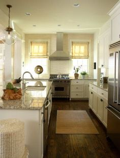 low light kitchen...love the mix of wood floors, white cabinets and warm granite counters..