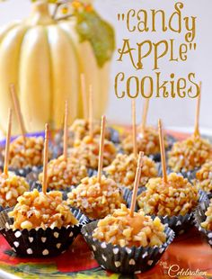 They look like the tiniest little apples, but they are really Candy Apple Cookies! Tender butter cookies dipped in caramel and walnuts, a great fall treat! At littlemisscelebration.com