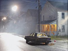 GREGORY CREWDSON  Production Still (Clover Street # 1), 2003.  Love the eerie vibe of the neighborhood, matches the K car nicely.