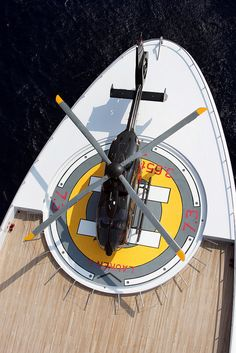 "tailrotor: EC135 on superyacht ""Lauren L"" by HeliHub.com on Flickr. shiny Echo Charlie 135 @ Monaco Yacht Show"