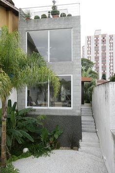 A contemporary design where the humble concrete block is the hero. Vertical spaces tied together...