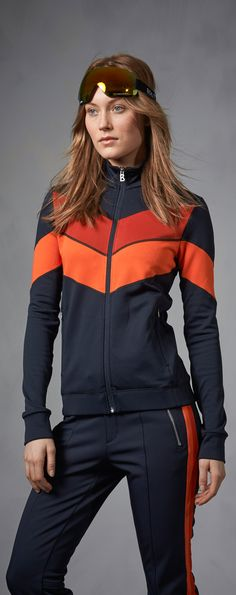 "Attitude is everything. This retro-inspired Bogner Fire + Ice tracksuit for women features bright, extra large racing stripes that say ""I'm ready for anything"", even when you're off the piste."