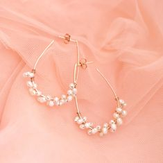 Rose gold earrings wrapped with pearls