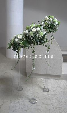 Fioreria Oltre/ Wedding ceremony/ Church wedding flowers/ White and green roses, white and green carnations, mums, baby's breath, ivy