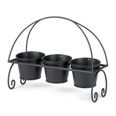 Adding cheer to your living space is as easy as 1-2-3! This adorable planter trio features three black metal planter pots that nestle into a scrolling black met