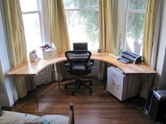 not loving the desk itself... but a great idea for a bay window.... could have used that in my condo!